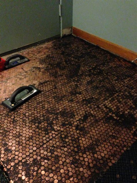 tile your floor with pennies copper penny floor installation pennyfloor pretty purple door