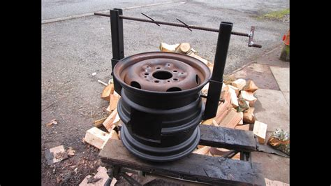 diy wood stove   car wheels easy welding project