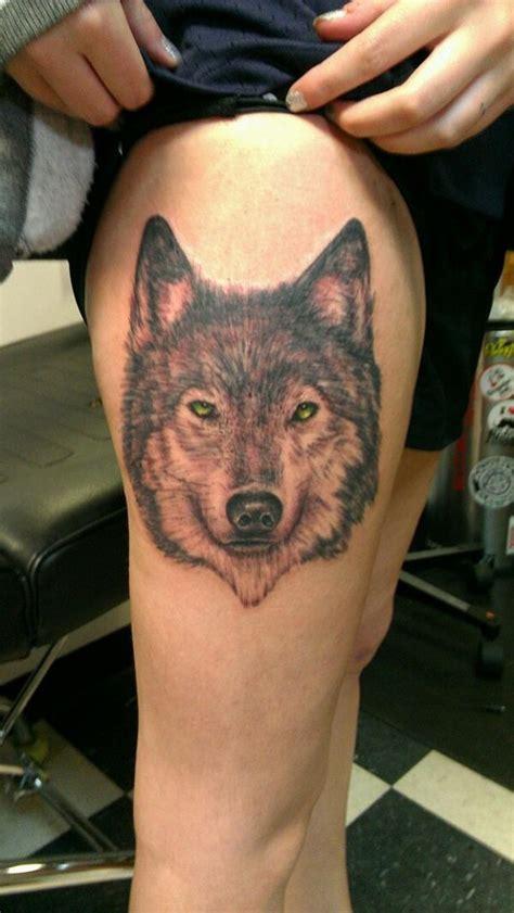 cool wolf  yellow eyes tattoo  thigh tattooimagesbiz