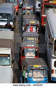 Tuk tuk motor taxis stuck in afternoon rush hour traffic ...