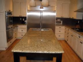 Golden Cabinets Stone Inc by New Venetian Gold Granite Installed Design Photos And