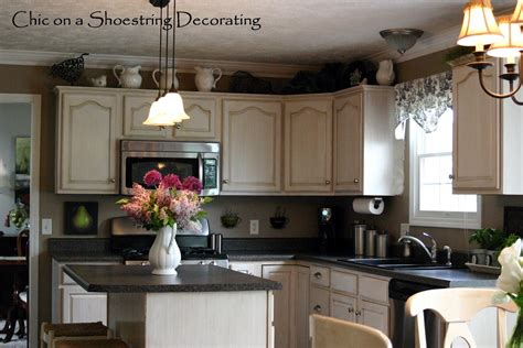 Decorating Ideas For Kitchen Cabinet Tops by Chic On A Shoestring Decorating My Kitchen