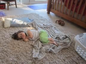 Little Girl Sleeping On Floor