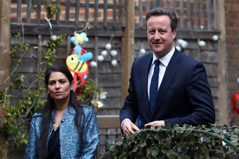 Prime Minister David Cameron plants flowers with children ...