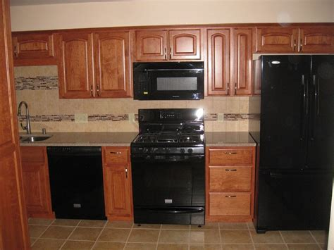 black backsplash kitchen l shaped hardwood cabinety gray glass backsplash tile