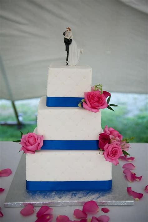 hot pink roses with royal blue on wedding cake a perfect