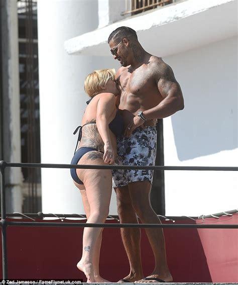 tye sheridan swimsuit kerry katona in a navy bikini as she packs on the pda with