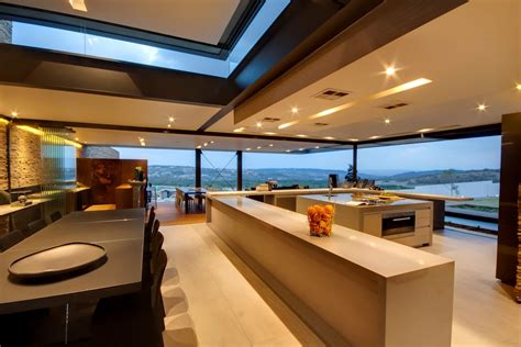 kitchen island dining table glass walls views luxurious modern residence  pretoria south africa fresh palace