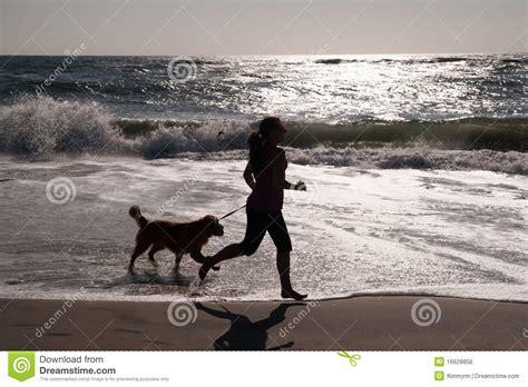 girl  dog running  beach stock photo image