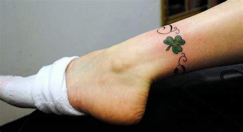 nice small shamrock leg band tattoo