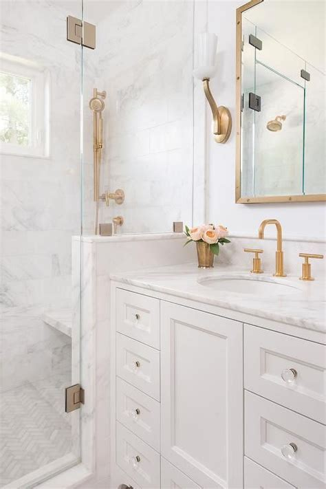 white  gold bathroom features  white washstand adorned