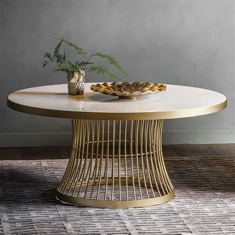 Its geometric design gives it a unique, modern look. Marble Topped Round Coffee Table - Gold | Primrose & Plum