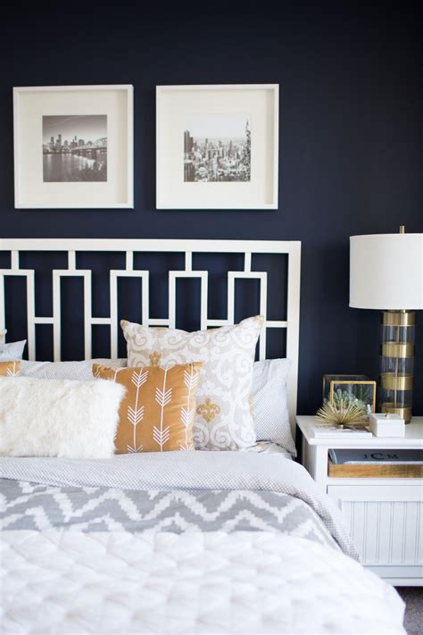 Ideas Navy Blue Walls by A Look Inside A S Navy And Mustard Bedroom