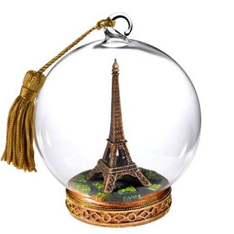 cut crystal eiffel tower xmas ornament glass globe and ornaments on