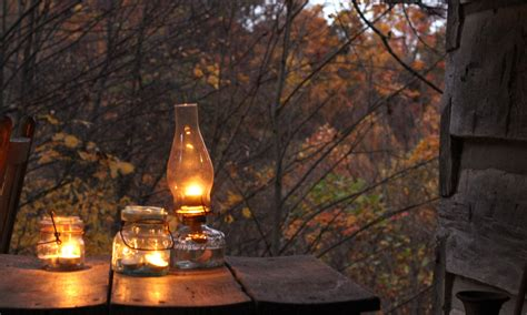 lanterns lit log cabin cooking