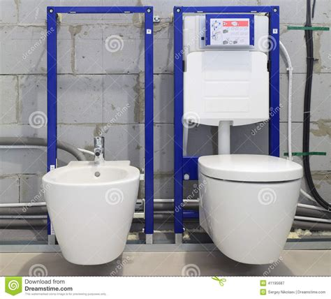 Bidet Toilet Installation by Installation Systems For Toilets And Bidets Stock Photo