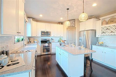 how to install kitchen island gorgeous kitchen with white cabinets and contrasting 7263