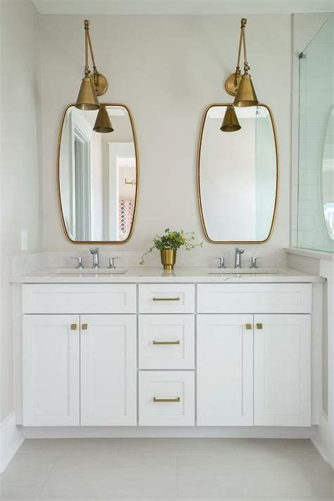 Brass Bathroom Mirror by Two Antique Brass Swing Arm Pendants Illuminate Two Brass