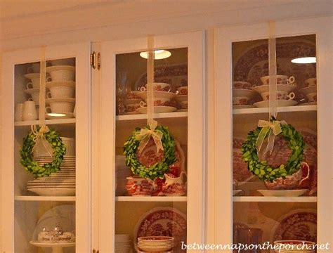 decorate kitchen cabinets  preserved boxwood wreaths  christmas