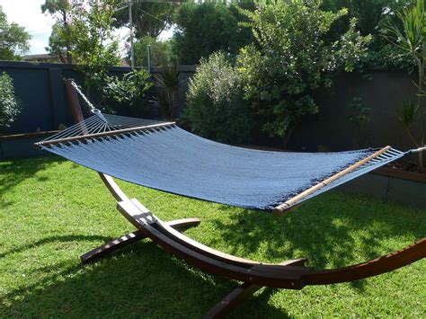 Wooden Hammock by Luxurious Wooden Arc Hammock With Caribbean Navy Blue