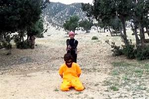 Islamic State child jihadi slaughters helpless prisoners ...
