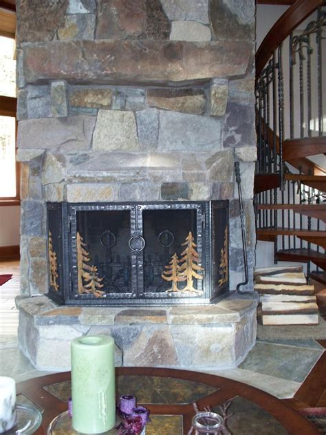Hand Crafted Stone Fireplace Remodel With Hand Forged Iron