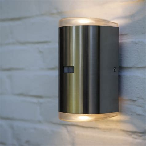 up and down wall light with pir lutec path pir 16w exterior led up and down wall light in