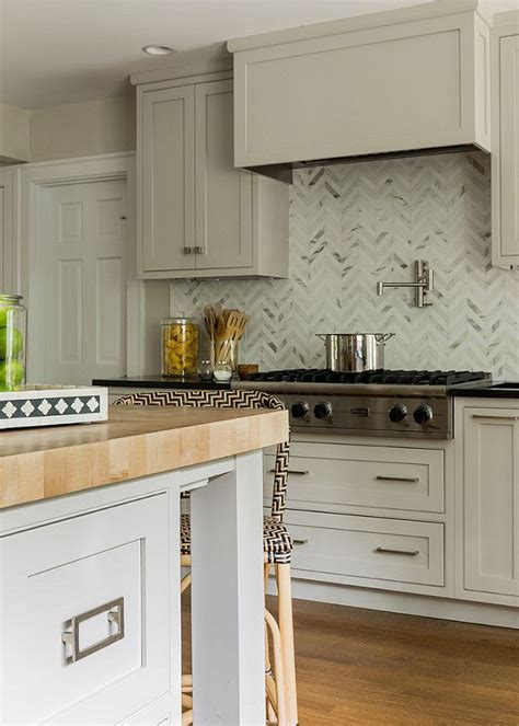marble herringbone backsplash marble backsplash in herringbone pattern maple butcher block island kitchen trends design