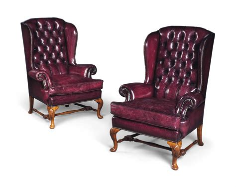 A Pair Of English Walnut High-back Wing Armchairs , Of