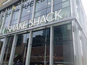 Customers wait in the cold for Shake Shack opening in ...