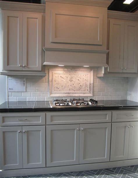 grey kitchen cabinets with backsplash gray cabinets black counters slate herringbone floor