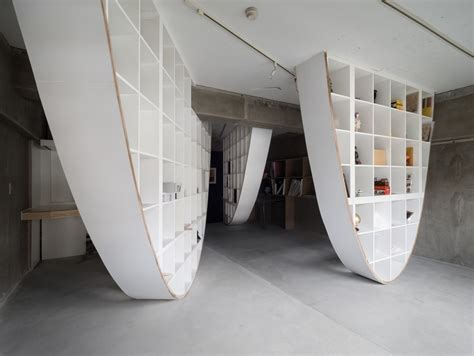 floor to ceiling shelves ikea japanese designer hacks ikea shelf to create floor to ceiling parabolic shelving mixed sign