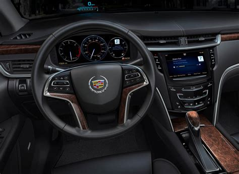 cadillac cue gms luxury brand ups  infotainment game