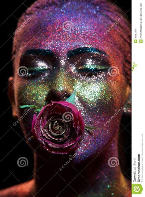 glitter makeup   beautiful woman face   black