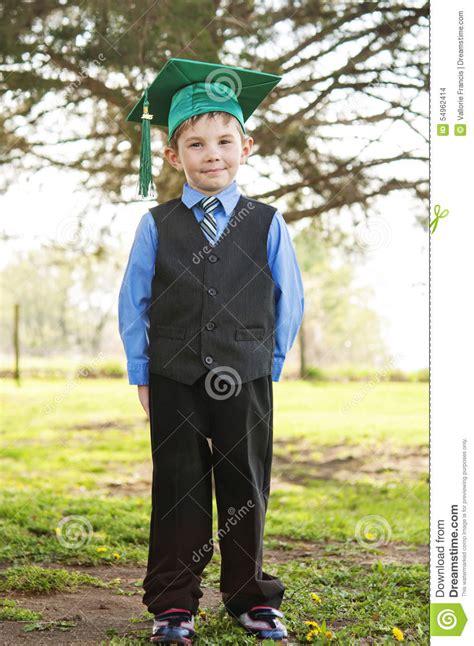 Boy Kindergarten In Suit Tie Cap And Tassel Stock Photo - Image 54962414