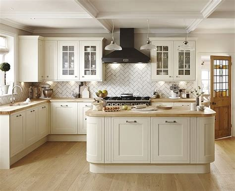 antique looking kitchen cabinets this antique white kitchen offers a timeless look 4111