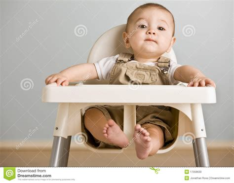 baby sitting in highchair stock photo image 17058630