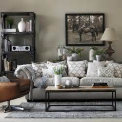 grey livingroom grey living room with chesterfield sofa and industrial style shelving grey living room ideas
