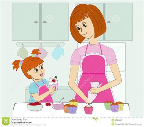 la cuisine des filles enfantez et sa fille faisant cuire dans la cuisine