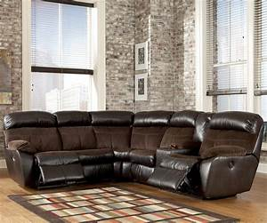 Signature design by ashley berneen coffee reclining for Sectional sofas by ashley furniture