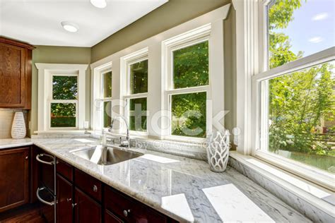 kitchen sink with marble top kitchen cabinet with marble top and sink stock photos