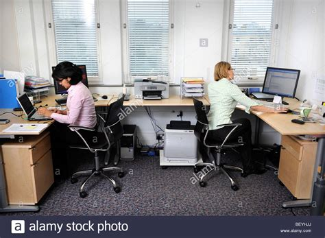 Creating A Small Home Office by Two Working In A Small Office Uk Stock Photo