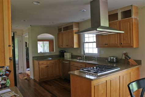 how level do cabinets have to be for quartz raising kitchen cabinets to the ceiling kitchen cabinet