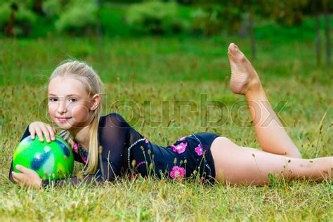 outdoor portrait of gymnast with on grass stock