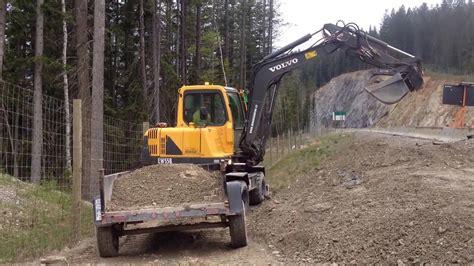 wheel excavator  dump trailer youtube
