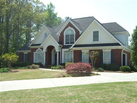 Surprisingly Brick And Stucco Homes by Brick Stucco White Trim Black Blue Shutters