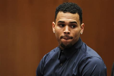 Chris Brown denies giving daughter Royalty asthma with