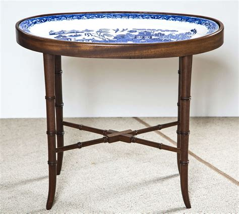 faux bamboo table l faux bamboo table fitted with blue willow oval platter at