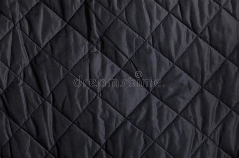 black quilted fabric background stock photo image