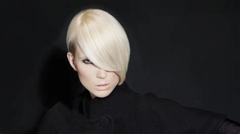 Sleek And Silky Short Hairstyle With A Sloped Fringe Area